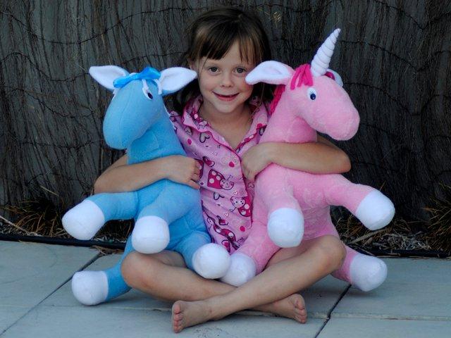large horse and unicorn soft toy
