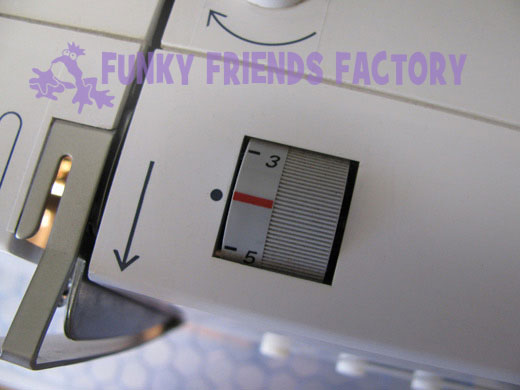 Sewing machine check tension control dial