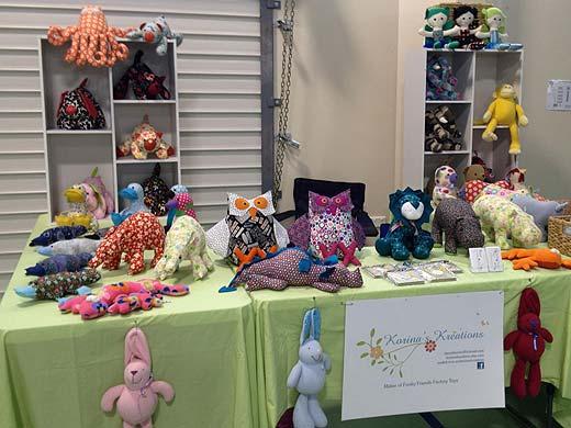 Korinas - Kreations - market stall selling softies