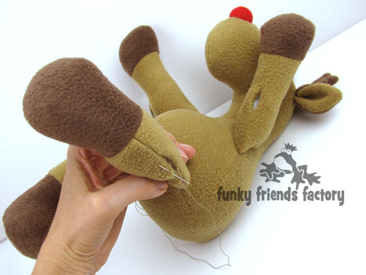 Sew up arms and legs of reindeer