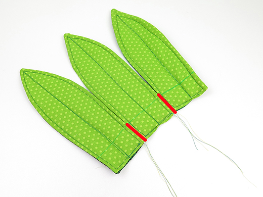 sew large leaves together