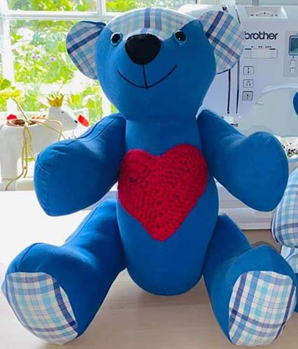 Calico bear with heart sewn by GlynisDuckenfield