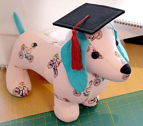 Dachshund toy graduation cap sewn by Korina Fraser