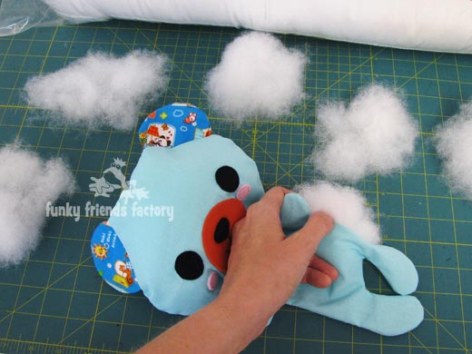 Use small bits of toy stuffing