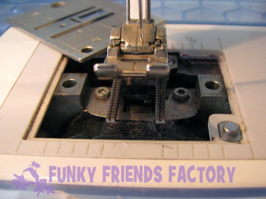 remove the needle plate dust fluff lint in sewing machine